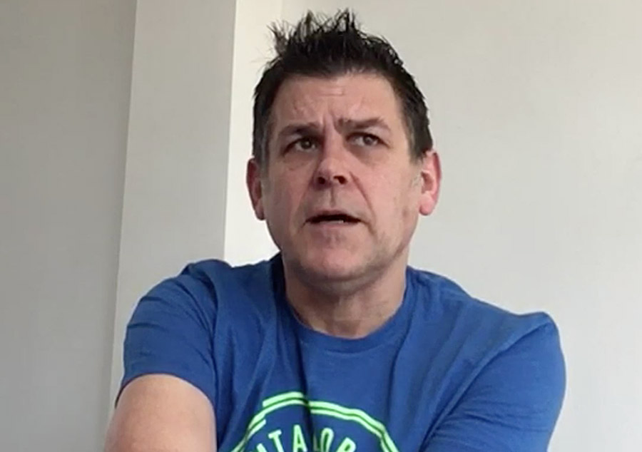 Middle aged man wearing a blue tshirt